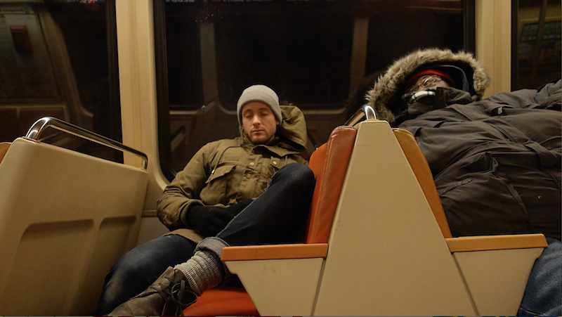 Filmmaker Bryan Bello rides the metro with Director Levester Green. Photo courtesy of Bryan Bello.